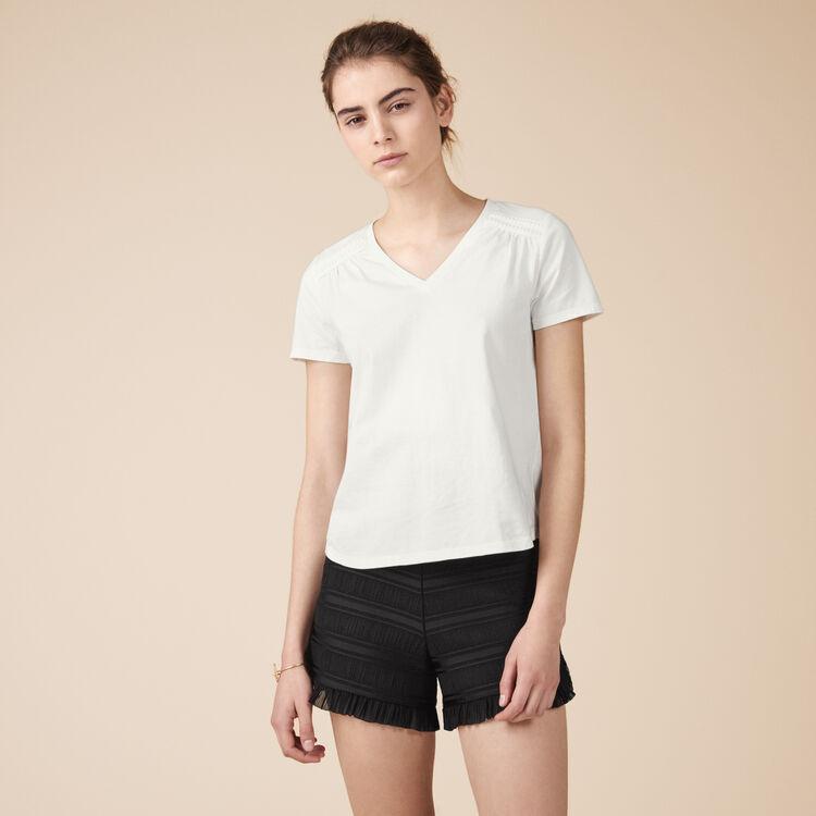Tee-shirt en coton avec détails - Hauts - MAJE
