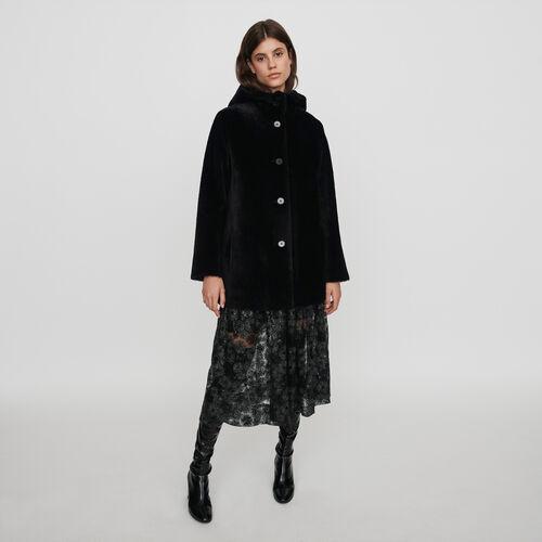 Peau lainée réversible à capuche : Manteaux & Blousons couleur Noir