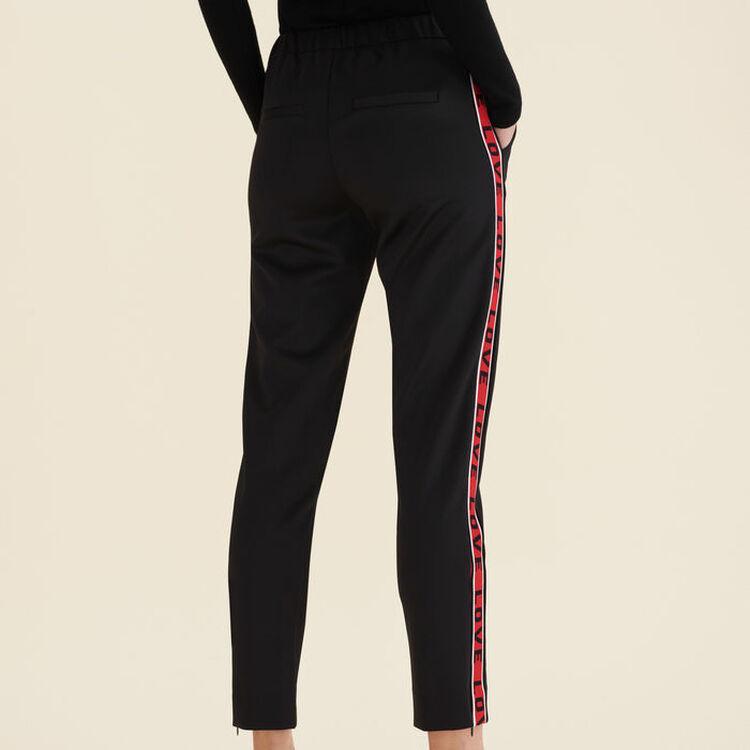 Pantalon en satin avec bandes : Pantalons couleur Black