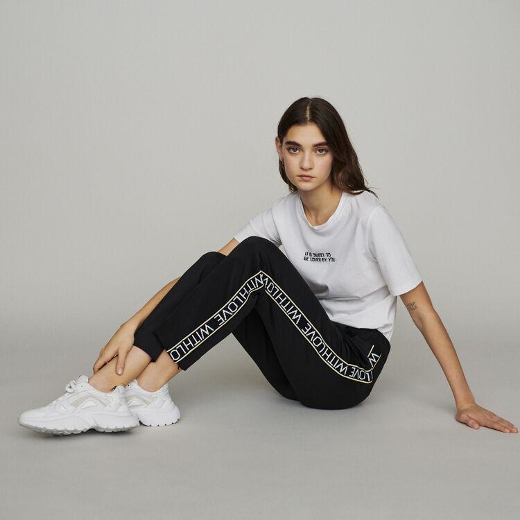 Pantalon élastiqué et bandes à message : New in : Collection Été couleur Black