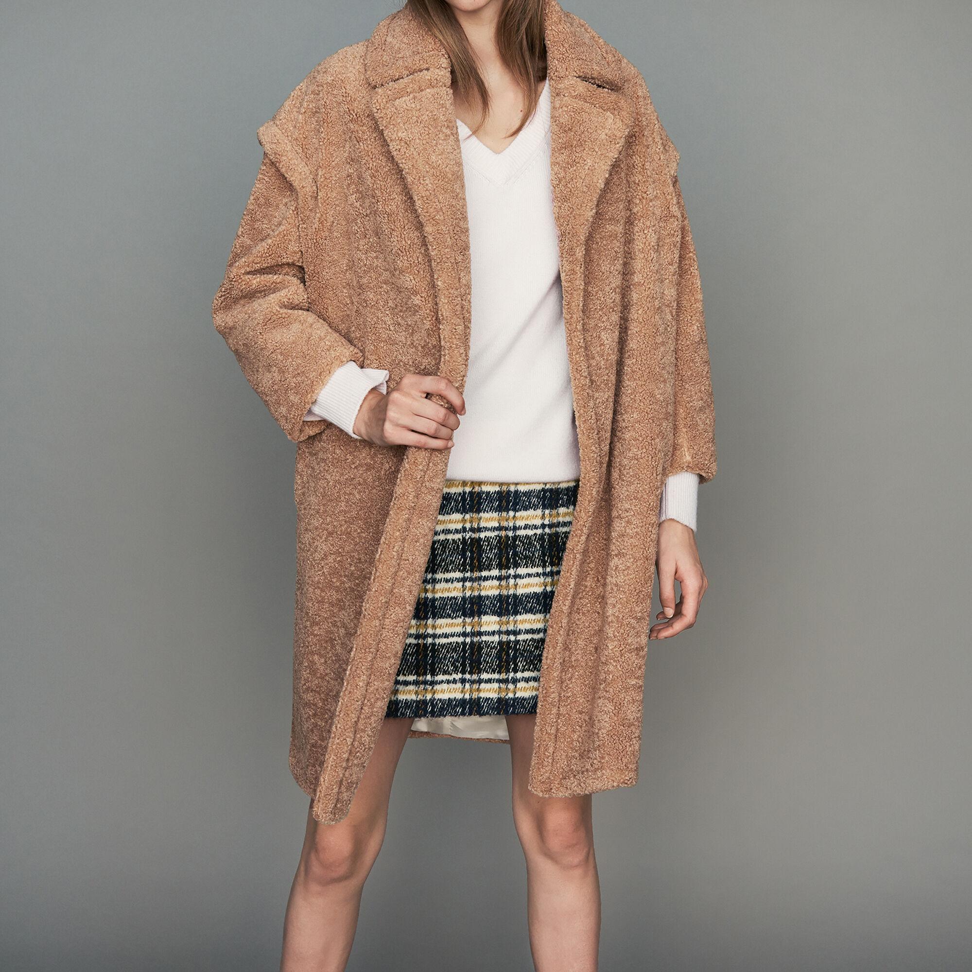 Manteau droit sans col noir femme